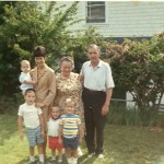 Dan's brothers and grandparents standing in front of Astoria house, circa 1970
